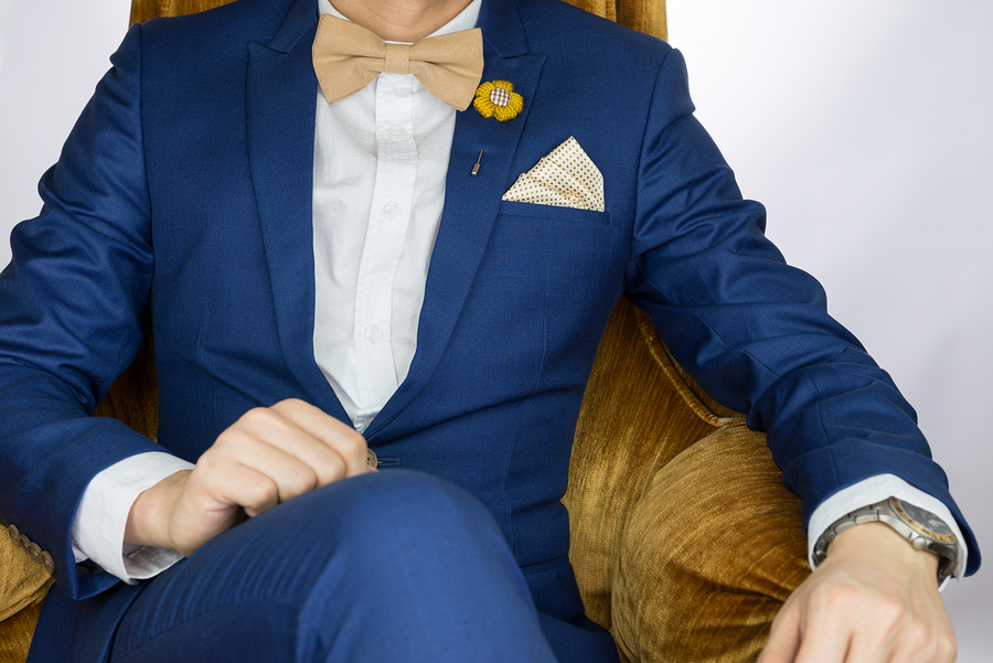 Man Blue Suit Sitting On Cozy Sofa